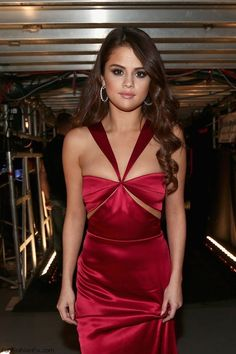 Selena Gomez in Cushnie et Ochs red satin halter dress at 2016 Grammy Awards. #selenagomez