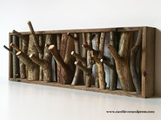 The wolf den coat rack is made from reclaimed lumber, as well as timber and branches sourced from wind-fall and local arborists, ensuring a new life for these limbs that took so much time to grow.