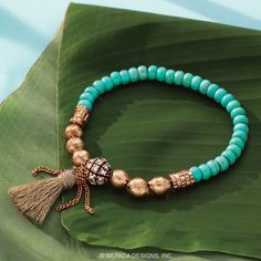 Caribbean Cool Stretch Bracelet. Color your world with this Turquoise Bracelet from the K & R Collection. With chunky turquoise and gold-colored beads, this Stretch Bracelet comes together with a trendy fringe tassel for an extra-fun look. Try pairing it with the complementary Dominica Details Necklace for an added dose of cool color.