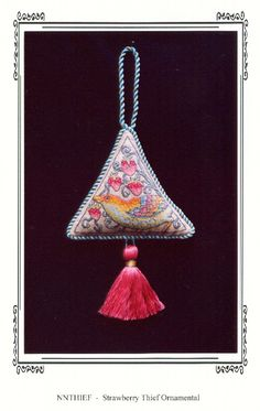 Strawberry Thief Ornamental by Sharon Cohen of Nostalgic Needle.  Does anyone know where I can get the chart, please?