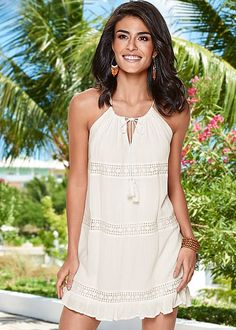 Jump from island to island in this keyhole mini dress!