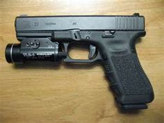 Glock 22, with TRL1 weapon light. It's a Gen 3...personally prefer the 4 - for the backstrap adjustment.      Used to hate Glock. Until it became my duty weapon & I HAD to rely on it. Now? It's an amazing weapon. And will also be my go to for defense or work.