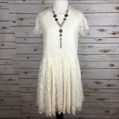 """[Free People] Stardust Lace Mini Dress Boho Grpsy Delicate lace floral fit and flare mini dress with eyelash lace trim. Rounded neck with a low scoop back. Adjustable back tie neck. Lined. I think this runs big and could fit a Small!  Fabric: 63% Cotton 37% Nylon Bust: 18"""" Length: 34"""" Condition: NWT!  No Trades! Free People Dresses Mini"""