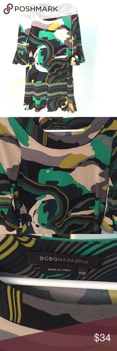 BCBG 3/4 length ruffle sleeve dress BCBG dress with 3/4 ruffle sleeve and ruffle detail bottom. Perfect with boots or booties. XXS BCBG Dresses Long Sleeve