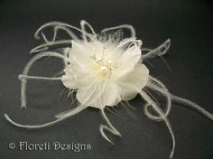 """Fragile in nature, Floreti couture silk Mermaid Rose is jewelry. Mermaid Rose bridal hair clip, fascinator custom-made of light ivory silk. Adorned with white freshwater pearls, tiny crystals on silver wire, and delicate ivory feather accents.   Looks beautiful worn alone in hair or with a veil or headband. Last image shows an """"in hair"""" example of 2-1/2 inch white Dogwood rose"""