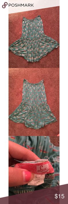 Teal Patterned Dress not sure what to call the pattern haha. tube type of dress. only wore a few times. * not brand that is listed Abercrombie & Fitch Dresses Strapless