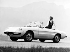 black not white. Such an awesome crossover, so fun in the summer, top down my blue bully in back doggles scarf blowing in wind... Alfa Romeo Spider Veloce 1750, 1969-1971