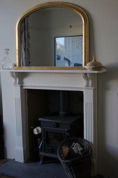 Woodburner with mirror, woodbasket.