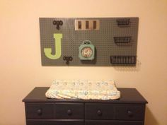 Look at this cute pegboard for my sisters baby boy!  It's in the nursery above the changing dresser!  So cute!  See blog for how to details!  http://www.blissfullychicdiy.blogspot.com/2014/05/pegboard-for-baby-boy-nelson.html