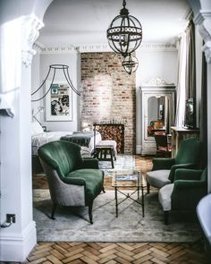 Dreamy hotel room. I love the textures at Artists Residence from beautiful parquet flooring to the exposed brickwork, with the lush green velvet. #luxurybedroomsuite