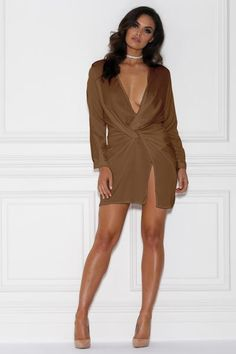Capture the attention of all the people in the room with this satin dress. Featuring a relaxed fit, twisted knot, plunging neckline, and thigh-high slit, it is