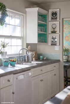 Lia_Griffith_Scandinavian_Kitchen_2: I love the pretty blue glass tile but I would have placed it all the way up to the cabinets.