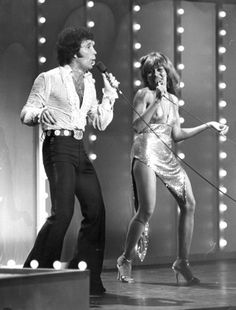 Tina Turner, pictured here in a 1978 concert with Tom Jones, was famous for her sparkly gold minidresses.  Joe Heiberger/ Joe Heiberger