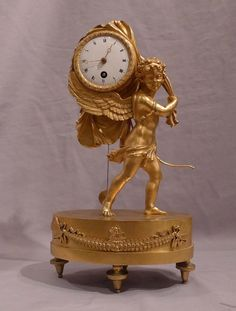 Antique French Empire miniature mantel clock of Cupid carrying time. - Gavin Douglas Antiques