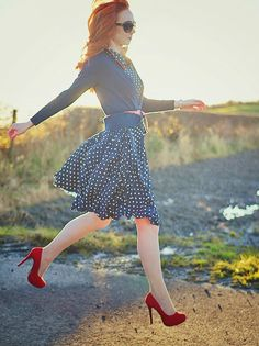 This one reminds me of my favorite redhead Andrews! :D <3  Red pumps and navy and White polkadot dress