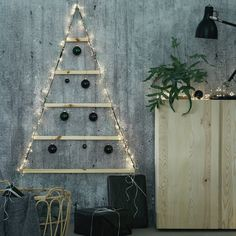 A christmas tree can turn any space into a magical place! Try out a more contemporary look with this simple and unique christmas tree alternative, which can be used as a beautiful wall decoration piece the whole year around. The best: It fits in a small area, is made of sustainable materials and is 100% needle free. #myIKEA #IKEA #christmastree #VINTER2020 #christmasdecoration #decorationinspo #scandinavian #skandi #sustainable #Weihnachten #Weihnachtsdeko #ikeaideas #interior #design #home