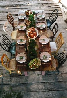 Before the whole family gets together, enjoy a meal with your other family: your friends. Set a casual scene with Stella Artois, mismatched chairs and a wide variety of sides. Look here for more inspiration on both food and decor for your Friendsgiving. Mismatched Dining Chairs, Table And Chairs, A Table, Rustic Table, Room Chairs, Patio Table, Office Chairs, Farmhouse Table, Mismatched Table Setting