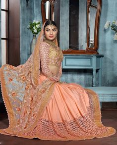 Peach sari with zari resham floral embroidered pallu   1. Peach net satin embroidered sari2. Golden resham zari and sequins embroidery with golden embellished heavy border3. Comes with matching unstitched blouse4. Can be stitched up to size 42 inches