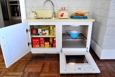 Young House Love - repurpose an old kitchen cabinet into a play kitchen for Baby. I have just the cabinet for this...