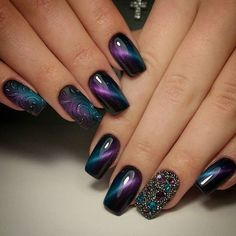 These two colors look as royal. Colourless shiny gel on matte nail looks very classy. Extravagant rhinestones on one nail is very royal.