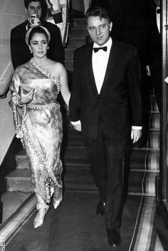 Elizabeth Taylor's Golden Gowns Go to Auction | ELLE UK ~Elizabeth Taylor in Balenciaga 'Sari' gown with Richard Burton 1964 #fashion