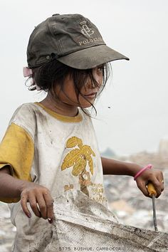 Children pick garbage for a living amid the fly swarms and stink of Stung Meanchey landfill in Phnom Penh, Cambodia.  photo credit:  mjbeng