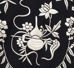 Hand embroidery detail of shawl . . .   1920s  . . .  black silk crepe with ivory padded satin stitch embroidery . . .  Antique shawls at Vintage Textile: Chinese embroidered shawl