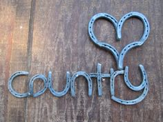 Horseshoe 'heart' Country Sign  Rustic Country Western Home Decor By Rustic and Country, $130.00  Handmade, made in the USA. Wouldn't this look great in your living room?