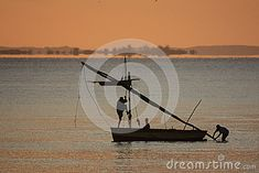 Photo about Silhouette of fishing boat at sunrise - Inhassoro - Mozambique. Image of heat, landscape, equator - 53541612 Fishing Boats, Sunrise, Fair Grounds, Silhouette, Stock Photos, Landscape, Travel, Image, Trips
