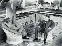 """The British Prime Minister and Aristotle Onassis on the Onassis yacht, 1959. They are sitting inside the empty on-deck pool with the """"Leaping of the Bull"""" Minoan mosaic below them."""