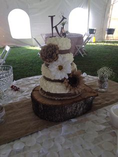 Rustic wedding cake burlap minus the big flowers!
