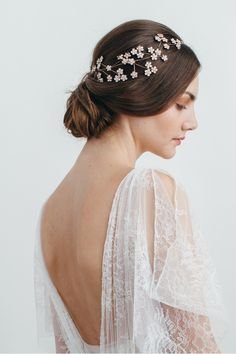 Camille Circlet - this incredible headpiece can be worn anywhere on the head. It's a gorgeous garden of floating flowers - once on the Swarovski flowers look like they are floating in the hair.