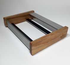 Korg Volca Skiff, single version. A stand for your Korg Volca synths. Made from oak wood and aluminum $40.