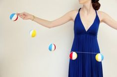 DIY beach ball garland- use Styrofoam balls, string & paint...