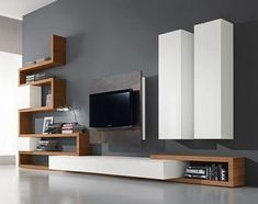 47 Amazing Wall Storage Items For Your Contemporary Living Room. Floating wall storage is a mix of practical storage and home décor fashion where the storage unit is fixed to […] Living Room Wall Units, Living Room Tv Unit Designs, Interior Design Living Room, Room Wall Decor, Living Room Decor, Modern Wall Units, Home Decor, Wall Storage, Rustic Furniture