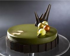 Dolcetto has a unique take on the festive log cake this year with its bronte pistachio cake. It's a round cake of Alkermes liqueur-soaked sponge -- layered with creamy pistachio mousse and topped with candied orange pieces and chocolate pearls. Gourmet Desserts, Just Desserts, Dessert Recipes, Plated Desserts, Dessert Original, Chocolate Garnishes, Decoration Patisserie, Pistachio Cake, Pastry Art