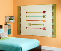 Straight and Arrow. Swirl and chevron quilting hit the bullseye, accenting the arrows in flight.