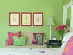 Pink accents bring a touch of softness and romance to this green teen girl's bedroom. A mix of patterns—stripes for the sofa and floral for the bedding—keeps the mood playful and fun.