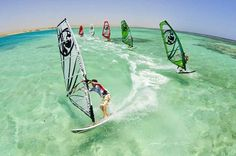 Book your trip to Sardinia, stay at Il Borgo Residenz in Porto Pollo and experience windsurfing Italian style!!