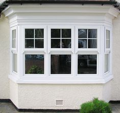 We Love this wonderful large bay window installation; complete with Rehau UPVC Windows, Bottom tilt and turn sashes, and top opening, half georgian bar sahses, finished off with sash horns. Upvc Sash Windows, Aluminium Windows And Doors, Arched Windows, Modern Windows, Bay Windows, Bay Window Exterior, Bay Window Shutters, Fairytale House, Double Window