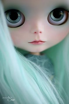 blythe doll with ice mint hair and a really beautiful choice of eye chip color to compliment her overall look.