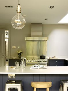 We specialise in residential interiors, providing a dedicated design and project management service. We create bespoke interiors tailored to our clients' style, personality and requirements. Stifkey Blue, Neptune Kitchen, Purbeck Stone, Belfast Sink, Exposed Brick Walls, Oven Range, Farrow Ball, Concrete Floors, Kitchen Lighting
