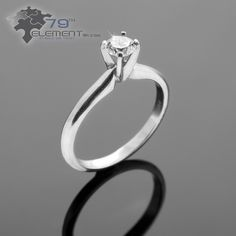 An engagement ring made of white gold with diamonds.Low prices  only in 79diamenty.pl,0