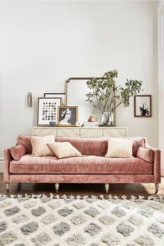 Inject some colour into your living room with this pink velvet sofa. Accessorized with cushions that compliment the Moroccan rug and sideboard to complete the look in this living space. Home Living Room, Living Room Decor, Living Spaces, Pink Velvet Sofa, Pink Couch, Deco Addict, Pinterest Home, Deco Design, Home And Deco