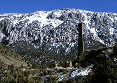 "Panamint City smelter ruins with snow-covered mountains - good map. Fun backpacking destination with lots of history to see! ""The Castle"" is the best cabin to stay in!"