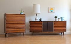 """Mid Century Modern dresser set made for Lane's """"First Edition"""" Collection. Includes low 9 drawer dresser, highboy dresser with 5 drawers, and two mirrors. Mirrors can be attached t..."""
