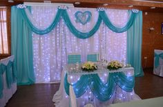 Light curtain with turquoise swags