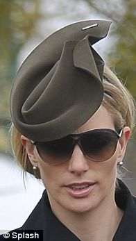 Zara Phillips on Day 3 -  A khaki coloured design set on a double headband worn with Tom Ford sunglasses