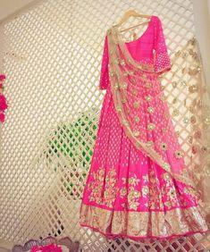 Pretty bright pink floor length anarkali with a golden dupatta top Anarkali Bridal, Anarkali Gown, Red Lehenga, Indian Bridal Lehenga, Saree Dress, Lehenga Choli, Bridal Sarees, Indian Wedding Outfits, Bridal Outfits