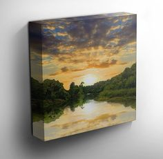 River Of Peace - This artwork on canvas features a pleasantly calm river with a gorgeous skyline reflection on the water. The ideal canvas print for a bedroom or hallway. - #canvas #art